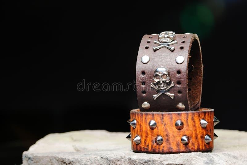 Armband med grova spikar och skallar royaltyfria bilder
