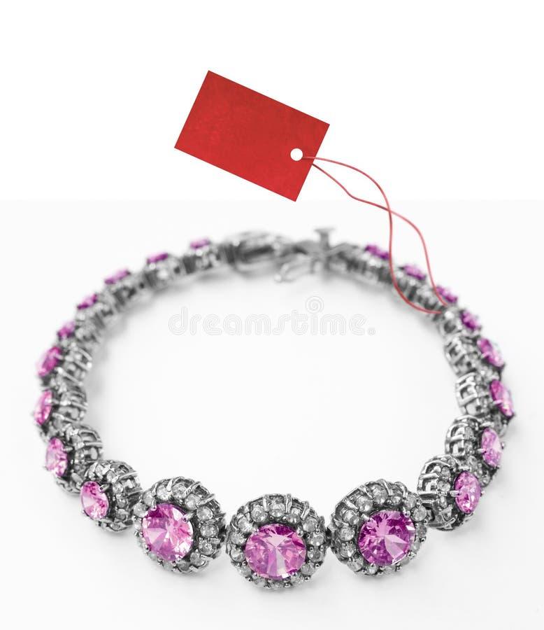 Armband met prijskaartje royalty-vrije stock afbeelding