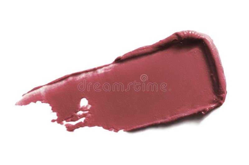 Armbanduhr-Abstrick auf weißem Hintergrund isoliert Nude Pflaumenfarben-Lippenstift-Textur Schminkschlag lizenzfreie stockfotografie