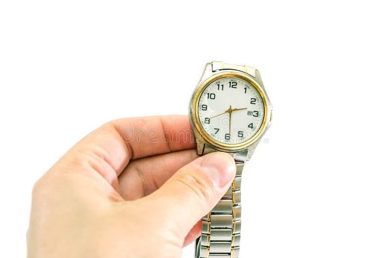 Armbanduhr in der Hand auf einem wei?en Hintergrund lizenzfreie stockfotografie