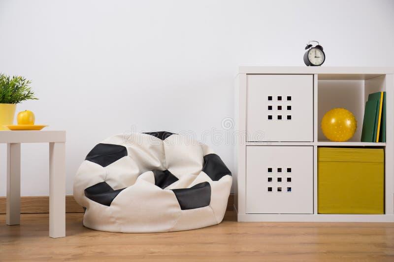 Armchair bag in bedroom. Fancy armchair bag in modern teenage bedroom royalty free stock photos