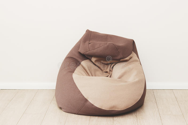 Armchair bag in the room. Combination of beige and chocolate colors. Loft style royalty free stock image