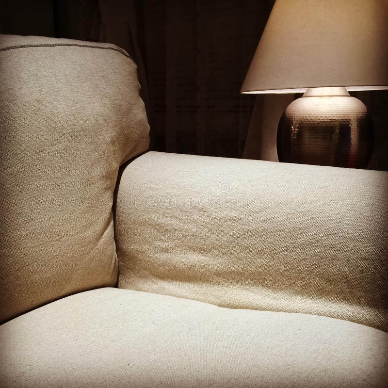 Armchair And Cozy Lamp Stock Photo