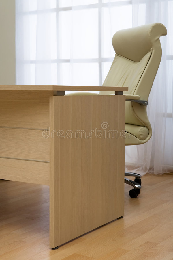 Armchair of director. On a background of a window royalty free stock images