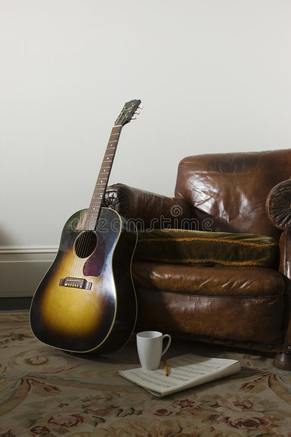 Armchair And Guitar Royalty Free Stock Images