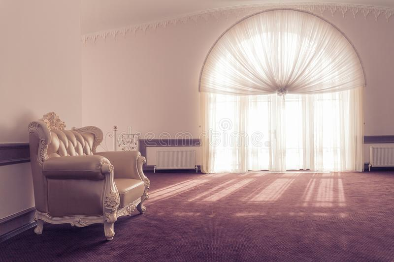 Armchair in a room with a large window stock photos