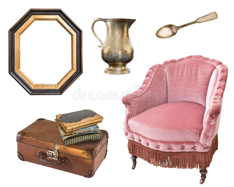 Armchair, suitcase, books, spoon, frame. Vintage, retro. Isolated on white stock photography