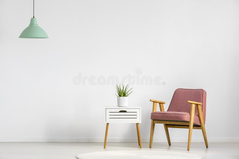 Armchair and table royalty free stock image
