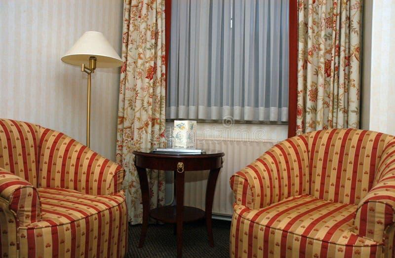 armchairs bedroom hotel royaltyfri foto