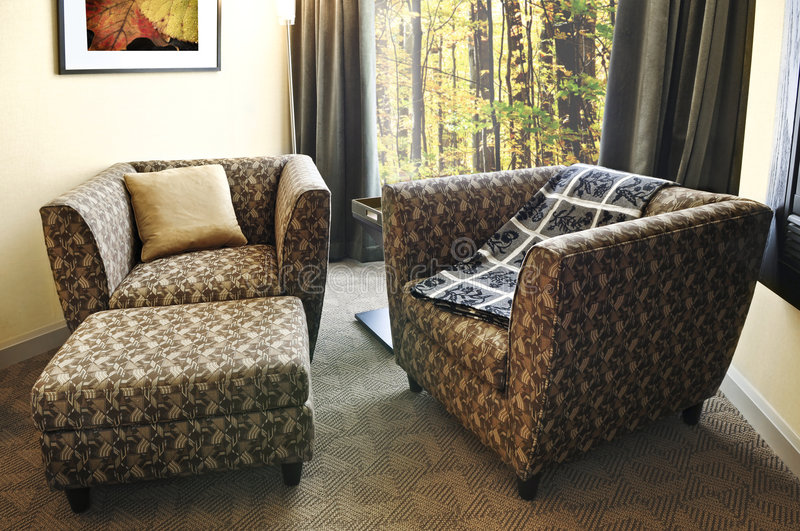 Download Armchairs with ottoman stock photo. Image of hotel, inside - 5289268