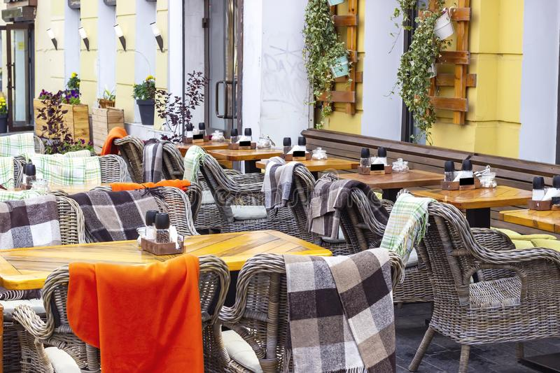 Armchairs with plaids of street cafe. Interior of a summer cafe royalty free stock photos