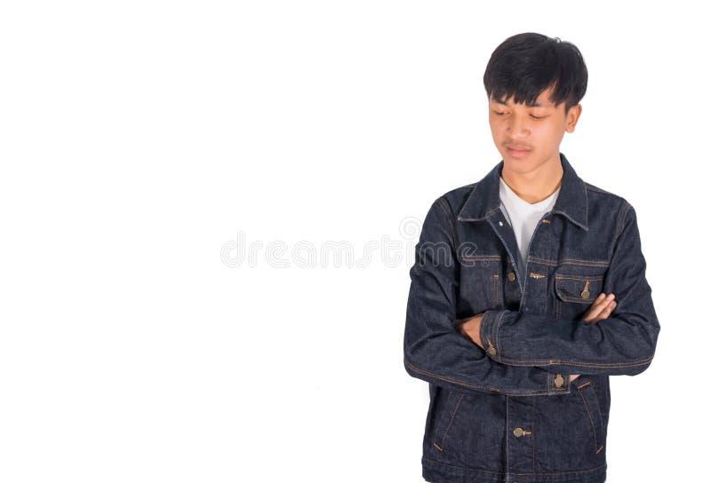 Armcroosing et s'attristent le type dans la veste de jeans photos libres de droits