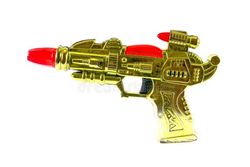 Arme à feu de rayon en plastique d'isolement sur le fond blanc, arme à feu de jouet photo libre de droits