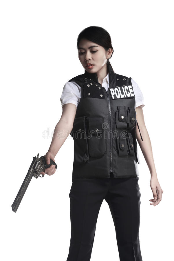 Arme à feu de revolver de prise de femme de police photographie stock