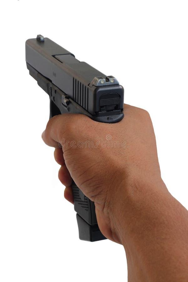 Arme à feu dirigeant à vous le fond blanc image stock
