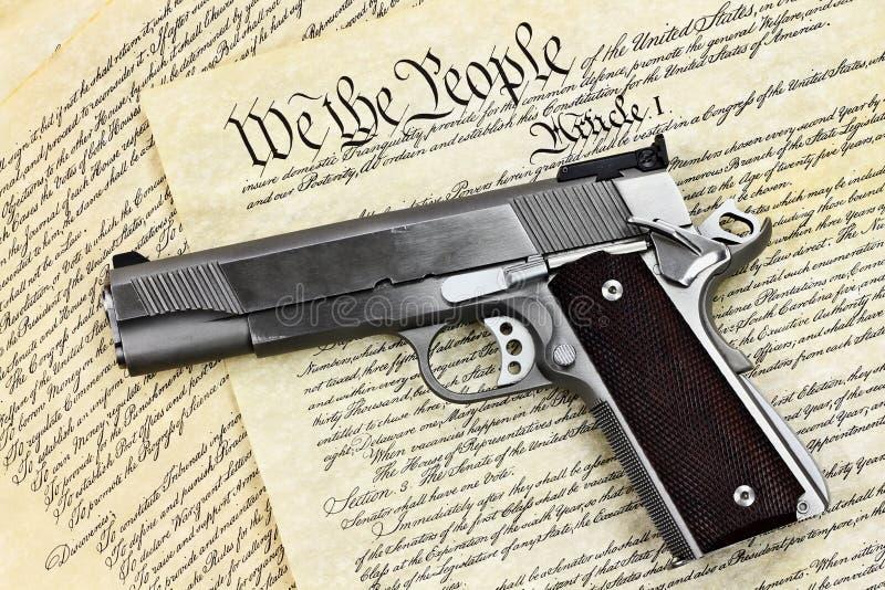 Arme à feu et constitution de main photo libre de droits