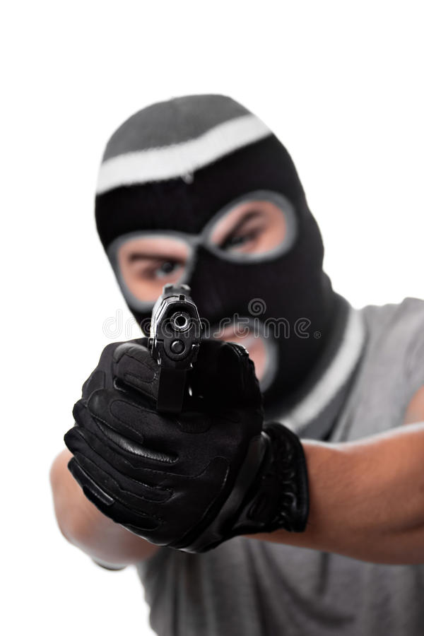 Armed Criminal With a Gun. An angry looking man aiming a handgun at the viewer. Works great for crime or home security concepts stock images