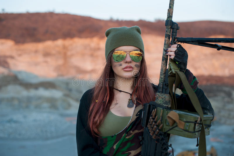 Armed girl on the background of the highlands royalty free stock photography