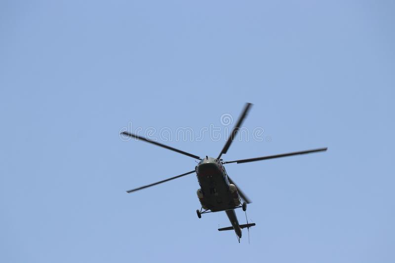 Armed Helicopter flying around the blue sky crisp shot royalty free stock photo
