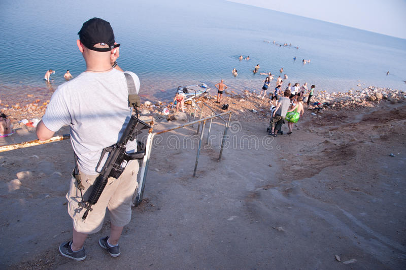Armed Israelis at Dead Sea royalty free stock images