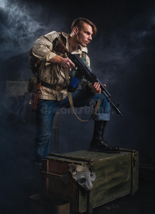 Armed man with a gun. Stalker. Armed man with a gun. Post-apocalyptic fiction. Stalker royalty free stock images