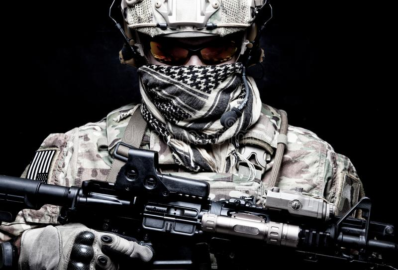 Armed marine rider portrait with hidden face. US Marine Corps soldier, army special forces fighter, modern combatant in camouflage uniform, battle helmet stock photos
