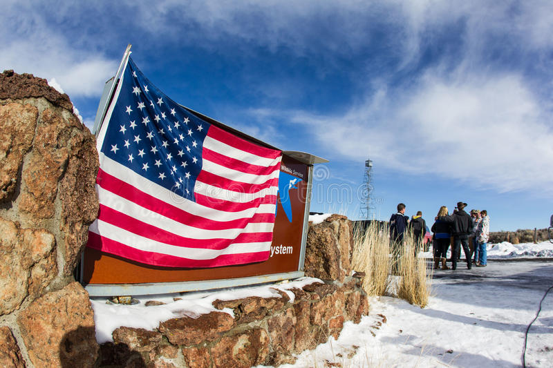 Oregon Armed Militia Standoff - Malheur Wildlife Refuge. A flag is draped over the at the Malheur Wildlife Refuge welcome sign and is the location of an armed royalty free stock photos