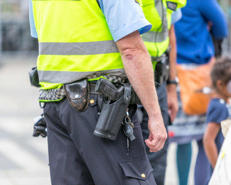 Armed Norwegian police. The Norwegian police are usually unarmed, but on occasions the wear sidearms stock image