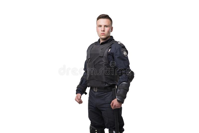 Armed police officer isolated on white background. Special force soldier in tactics ammunition royalty free stock photos