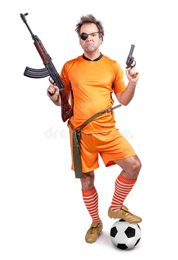 Armed soccer player. With the ball stands on guard stock images