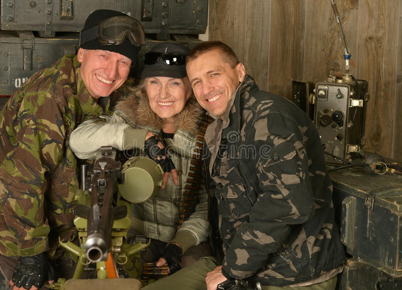 Armed soldiers in ammunition stock image