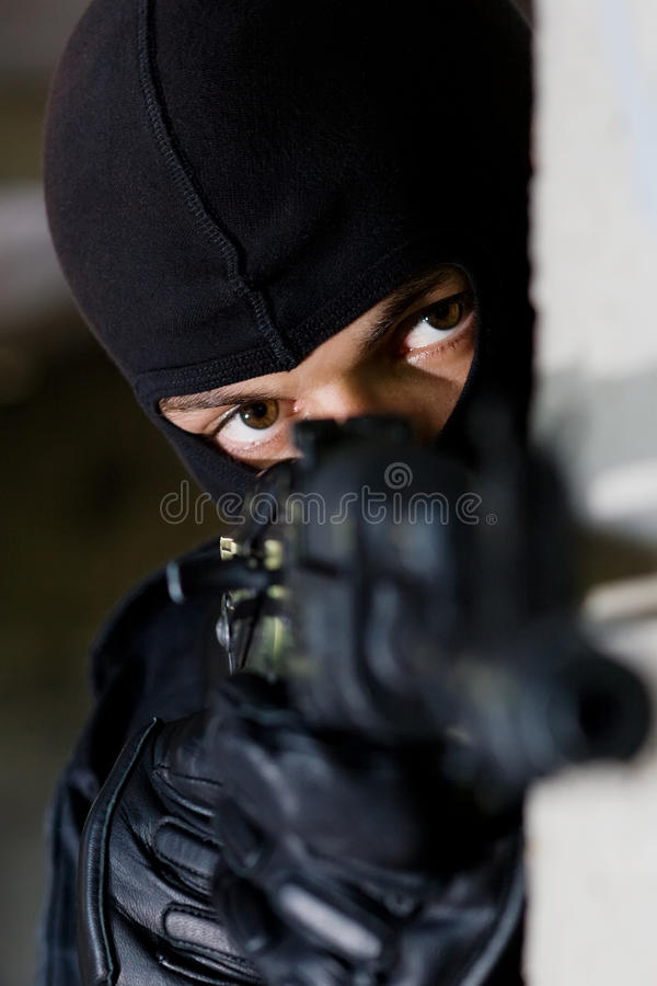 Armed terrorist aiming the camera royalty free stock images
