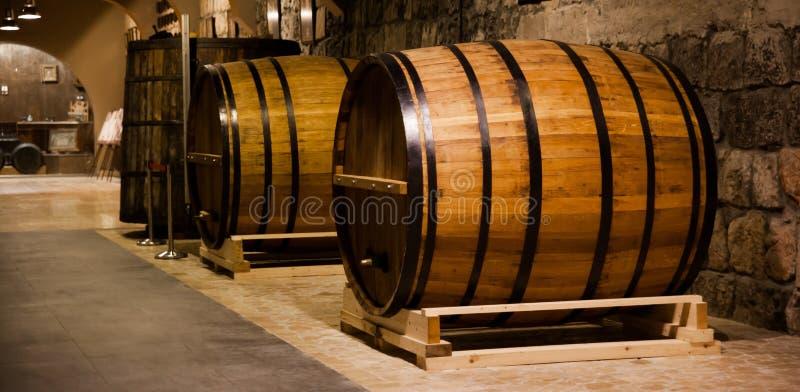 Armenia, cognac barrels. Cognac barrels in cellar old factory in Yerevan Armenia stock images