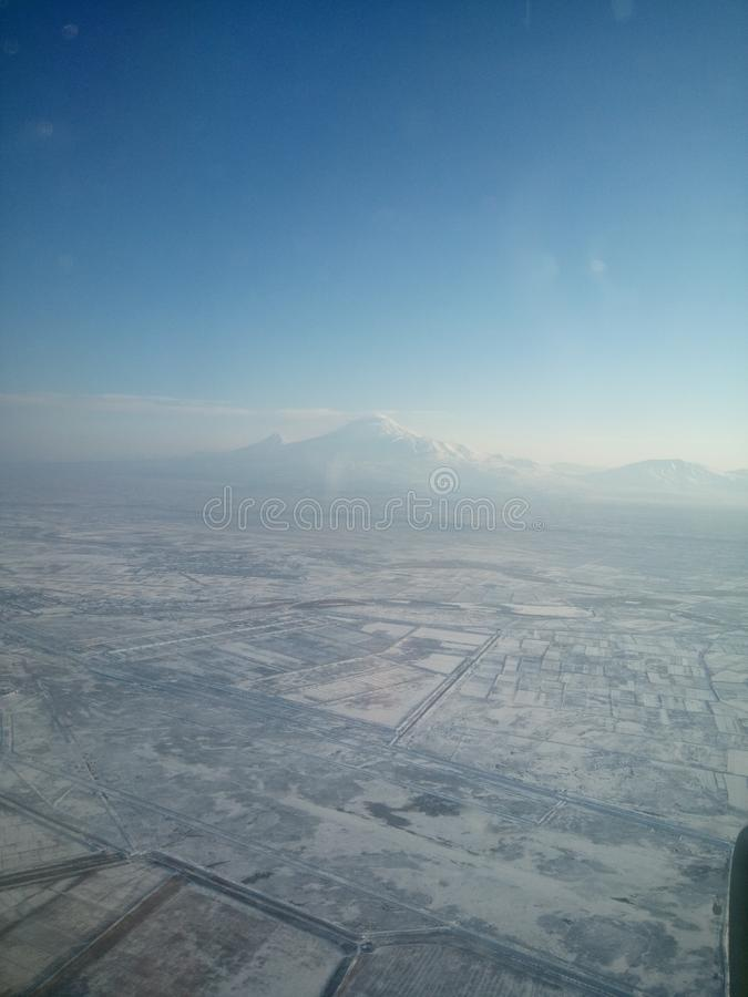 Armenia from the sky. And mountain Ararat Masis. And villages in winter royalty free stock photos