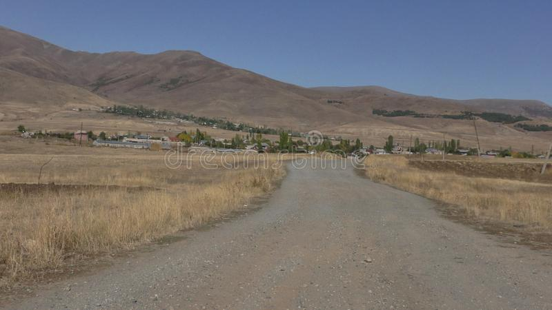 Armenia, Village road and fields angled view at Aragatsotn Province stock photo