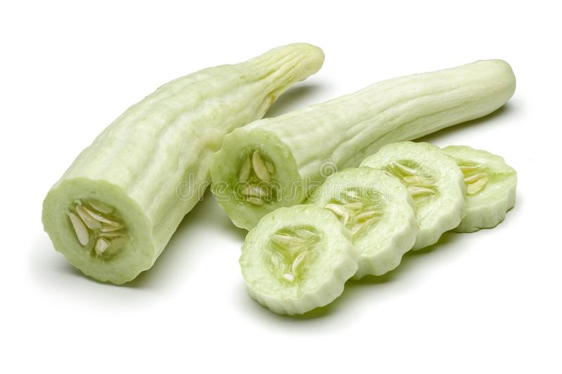 Armenian cucumber with slices isolated on white. Background stock photo