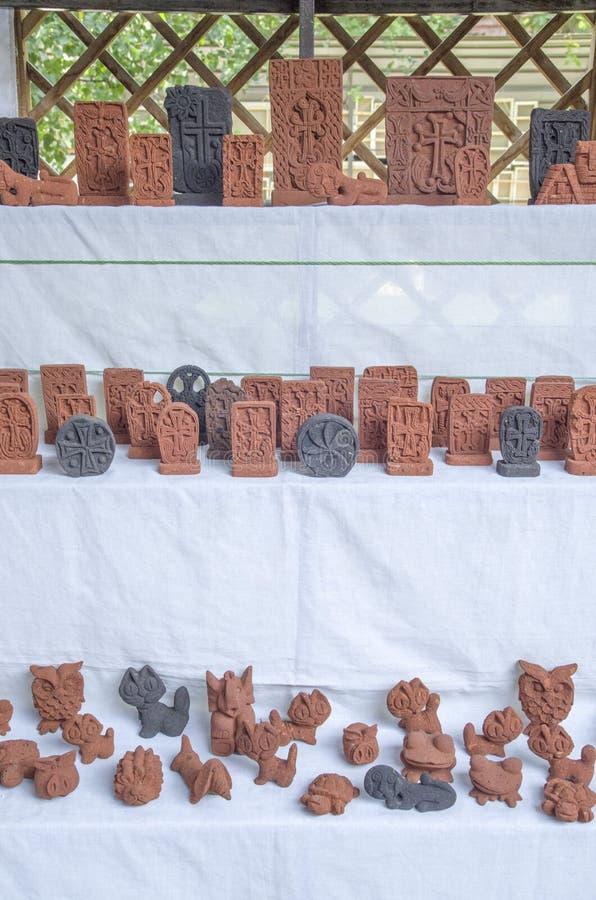Armenian small stone souvenirs - khachkar and animals stock images