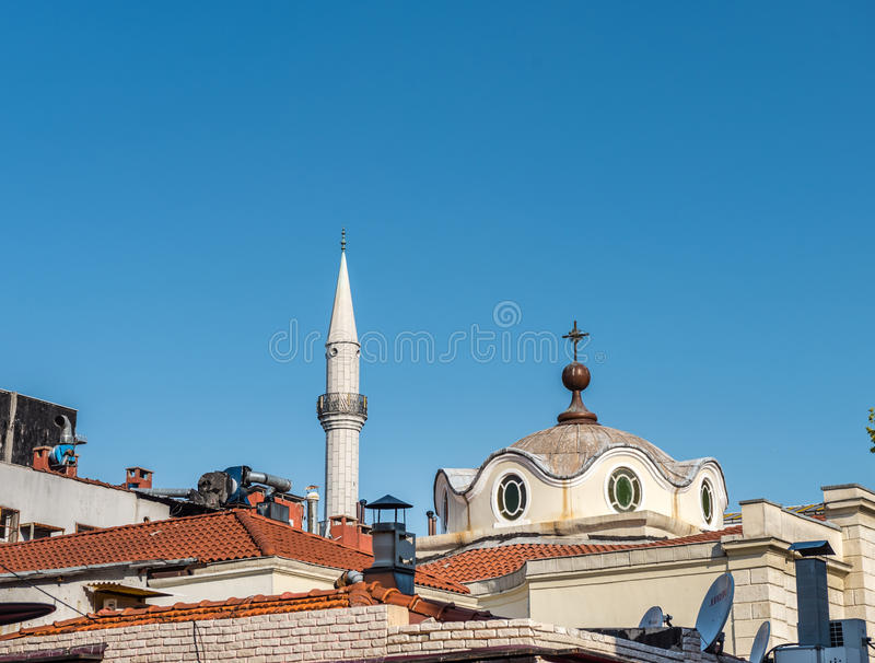 Armenian Surp Takavor Church and mosque minaret together,I. Exterior view of Armenian Surp Takavor Church and mosque minaret together,Istanbul,Turkey.Peace royalty free stock image