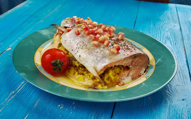 Armenian Trout dish. Kutap - Armenian dish,Trout stuffed with rice and spices stock photos
