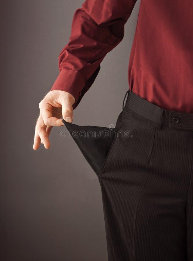 Geschäftsmann, der sein leeres Tascheninnere - heraus dreht stockbilder