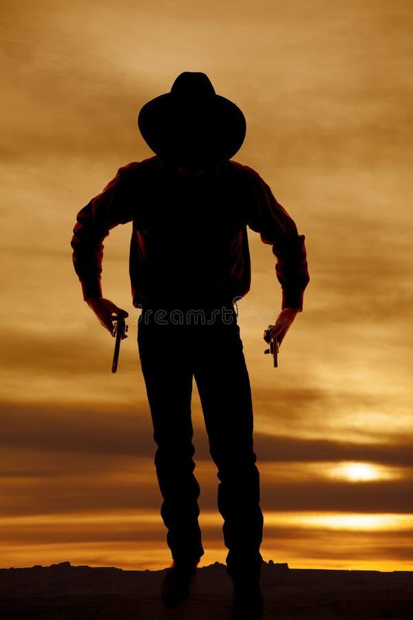 Armes à feu de la silhouette deux de cowboy photos libres de droits