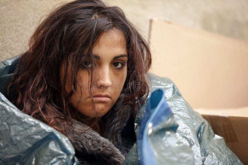 Armes Frauenportrait stockbild