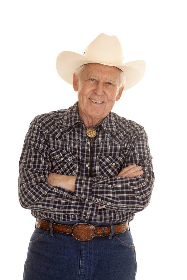 Armi anziane del cowboy dell'uomo piegate fotografia stock
