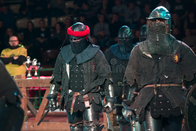 Armored fighters , dressed as knights royalty free stock images