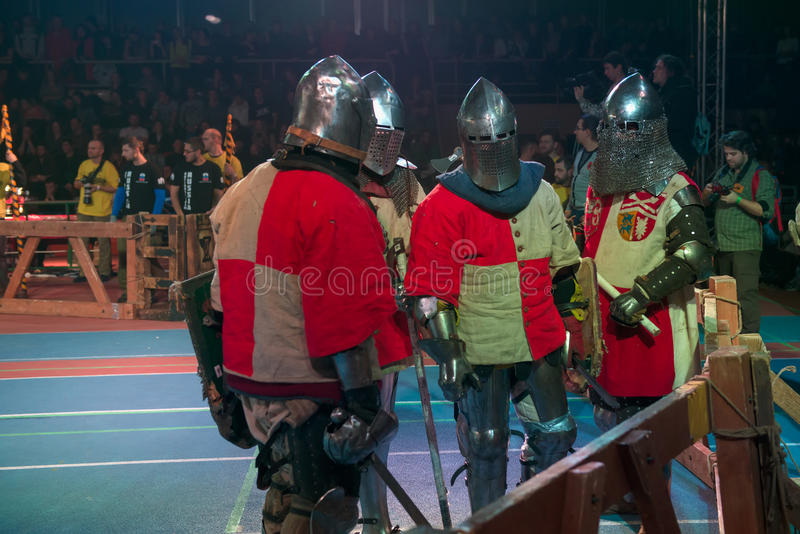 Armored fighters. MOSCOW - DECEMBER 03, 2016: Armored fighters , dressed as knights, fighting at the XI World championship in Medieval combat CUP `DYNAMO`. in stock image