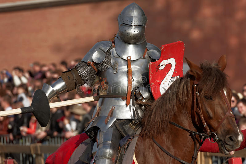 Armored knight participating in jousting royalty free stock images
