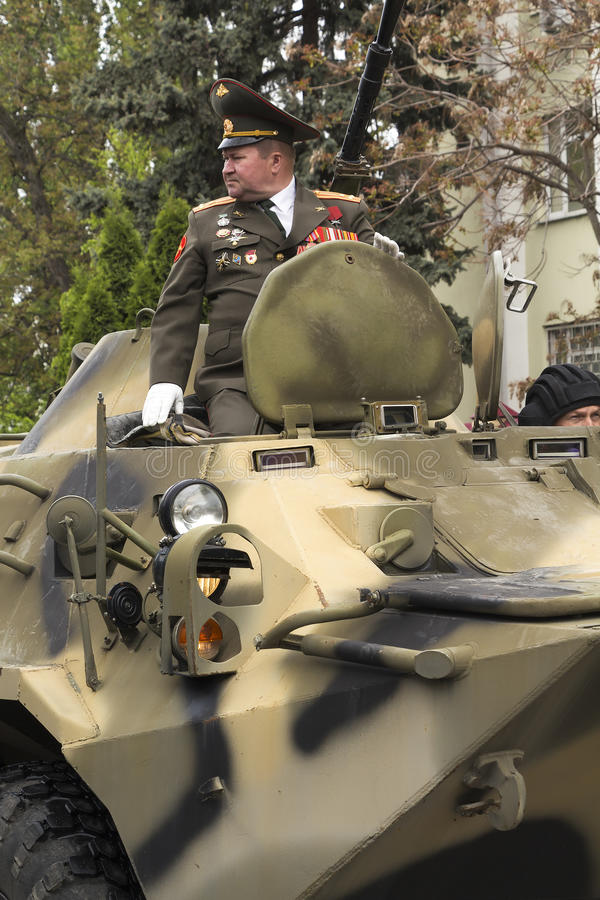 The armored personnel carrier heading a column of military equip stock photo