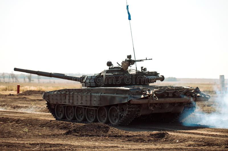 Armored Tank rides on off-road. Tank exercises in the countryside. royalty free stock images