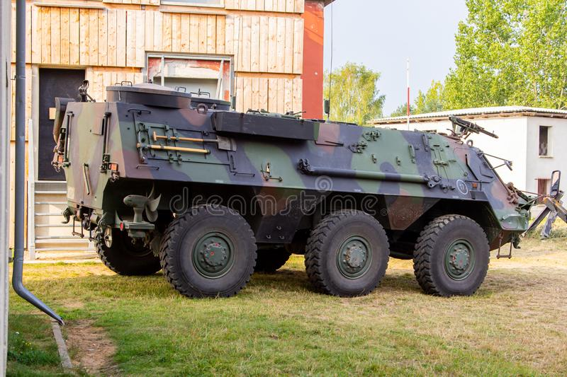 Armoured personnel carrier from german army. Stands in a military training area royalty free stock photography