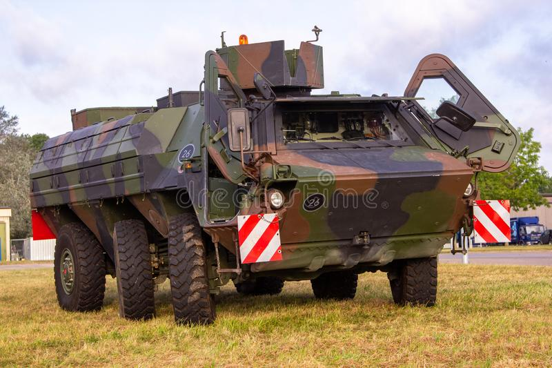 Armoured personnel carrier from german army. Stands on a field royalty free stock image